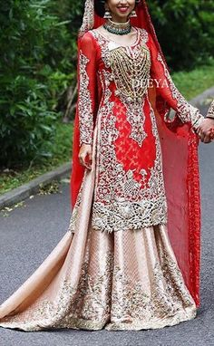 Pakistani punjabi bride wearing punjabi lacha-lehenga and kameez. Multani mala.