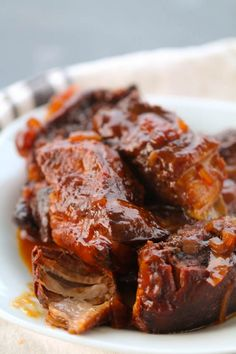 With boneless, country style ribs, liquid smoke, brown sugar, onion and bbq Slow Cooker Ribs Recipe, Slow Cooker Bbq Ribs, Crock Pot Slow Cooker, Slow Cooker Recipes, Country Ribs Slow Cooker, Crockpot Bbq Ribs, Beef Ribs Recipe, Vegetarian Crockpot Recipes, Pressure Cooker Ribs