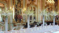 tall centerpieces with branches and orchids on decor of tablescape