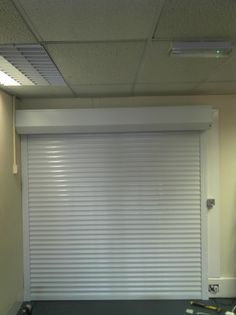 Continental Security Roller Shutter fitted to a store room of a commercial centre in Walthamstow Small Safe, Rolling Shutter, Commercial Center, Garden Design, House Design, Roller Shutters, Shutter Doors, Door Stop, Back Doors