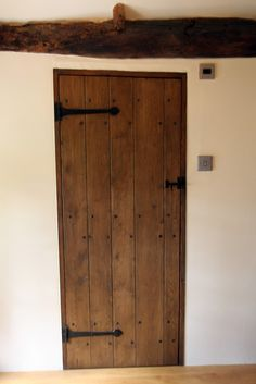Dark colored interior oak door for a thatched cottage.