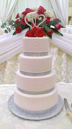 Gorgeous 4-tier wedding cake with rhinestone bling surrounding each tier.