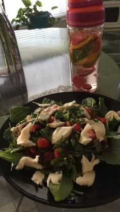 Caprese Salad- -Kale and baby spinach greens tossed in light creamy Italian dressing -Fresh Mozarrela -Tomatoes -Chopped Basil Topped with balsamic glaze  Remember always buy Organic and Non-GMO