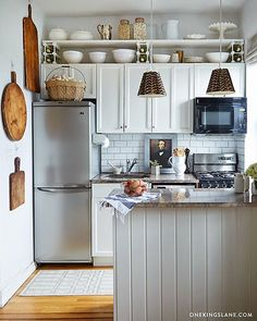 Open shelves above cabinets - form and function, likely reduces cost of cabinets as well.