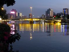 """Love River in Kaohsiung, Taiwan, was once described as an """"open sewer"""" but it has now been cleaned up and there are now lovely riverside promenades and even excursion boat cruises. Sun Moon Lake, Taiwan Travel, Seattle Skyline, Hong Kong, Boat, City, Travelling, Photography, Cruises"""