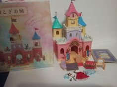 "Extremely Rare Japanese Sylvanian Families ""Misty Forest"" Fairy Castle with accessories included as shown in the photos! The box is included along with the JP booklet, genie lantern, blue crystal ""Cinderella"" slipper, magic carpet, rare red treasure chest, crowns, capes, etc. 
