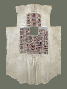 From Yunnan, this unusual old Yi tunic is probably from central Yunnan around Chuxiong. Made of 'fire weed', or hemp, it is quite heavy and no doubt warm. Oriented with the short part in front, the more heavily-adorned panel is worn at the back with the 'tail' gathered up and held by a belt. All ornamentation is done in naturally-dyed wool embroidery, and the edges of the neckline are covered in cotton tradecloth.