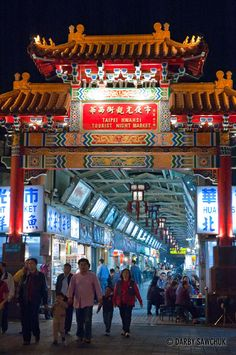 Chinese arch at the entry to Snake Alley Night Market in Taipei | Darby Sawchuk