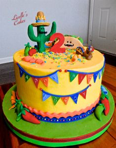 smooth buttercream with fondant decorations. Love the bright Mexican colours! Mexican Birthday Parties, 2nd Birthday Party Themes, Fiesta Theme Party, Taco Party, Birthday Ideas, Mexican Fiesta Cake, Mexican Party, Mexican Cakes, Mexican Desserts