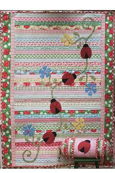 Natalie Ross in Stitches....such a gorgeous pattern! Could do a Jelly roll race quilt with applique on top. Could be lady birds or flowers on top.