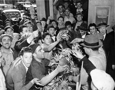 Crowd of people buying cheap crabs at Fisherman's Wharf (1938) via San Francisco Public Library