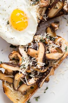 Healthy mushroom breakfast toast with a pan fried egg and Parmesan cheese.