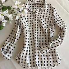 Black& White Popover Shirt White with black embroidered geometric shapes, this fun popover from Merona is classic and chic. Full length sleeves, buttons half way down, front breast pocket. Sz XS, fits TTS. EUC. ❌no off site transactions Merona Tops