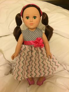 American Girl doll dress with polka dots, stripes, and pink bow detail.