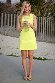 yellow summer dress, add a chunky neck piece and you have yourself a winner
