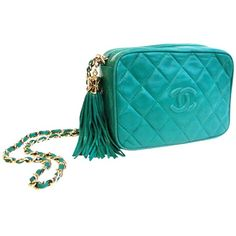 Green Tassel Bag ❤ liked on Polyvore featuring bags, handbags, clutches, genuine leather purse, blue leather handbags, quilted leather handbags, blue leather purse and blue handbags