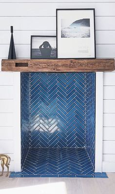 We finally have a tiled fireplace at the beach house! & Love the Adriatic Sea in this herringbone pattern. The stove is going in next week and then it& completed! Swipe right to see the before and during pics.