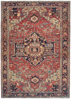 For lovers of tribal art, this vigorous room-size Serapi antique carpet shares the bold geometry and lively spirit of the best small antique rugs woven deep in the Caucasus Mountains.  Its naturally dyed palette is anchored by an exceptionally deep shade of midnight indigo, almost black in its extraordinary saturation.  Masterfully executed on a large scale, this 19th century antique Persian carpet's strong geometry and vivid coloration produce a dramatic and ...
