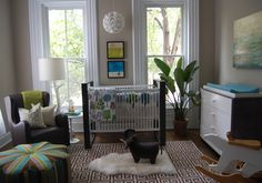 Neutral and modern baby boy nursery with pops of brown, blue and green.