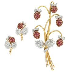 Two-Color Gold, Ruby and Diamond Brooch and Pair of Earclips, by Marvin Schluger