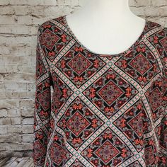 Contemporary style signature studio tunic This is a great tunic !!! Great for spring  make of 100% polyester. Contemporay style signature studio Tops Tunics
