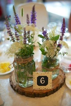 Wooden Rustic Wedding Centerpieces / http://www.himisspuff.com/rustic-mason-jar-wedding-ideas/16/