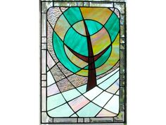 """ridescent pink sunshine with spots of sunlight dancing in the grass. The rippled irridescent glass and beveled border add more shine. As usual, pictures do not do this panel justice: the tree is much brighter compared to the background than it photographs, so see the close-up image for true colors.    I made this stained glass window panel panel using the copper foil or """"Tiffany"""" style method - so no lead came was used. The seams are patinaed into grey/black color. The panel has two loops on…"""
