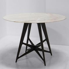 Entrance table by Ico Parisi, Italy 1940s. [Lacquered wood 'starburst' base with a circular Rosa Aurora marble top]