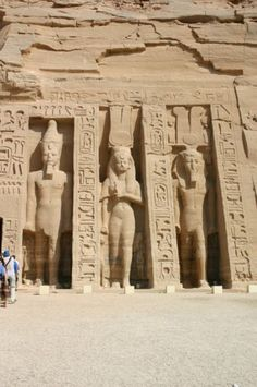 *TEMPLE OF NEFERTARI @ Abu Simbel, Egypt: The two colossal standing statues of Nefertari in front of the small temple are equal in size to those of Ramesses II. Nefertari is shown holding a sistrum. She wears a long sheet dress + she is depicted w/ a long wig, Hathoric cow horns, the solar disk + tall feathers mounted on a modius. TOMB 66: in the Valley of the Queens.