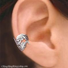 Hey, I found this really awesome Etsy listing at https://www.etsy.com/listing/61183970/dancing-feather-ear-cuff-no1-sterling