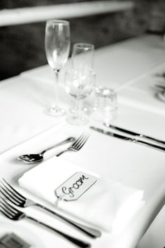 Groom table place setting with name place setting, cutlery etc. In a black and white finish. Photographed by Jinx Photography. www.JinxPhotography.co.uk