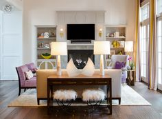 Custom bookcases and mantel designed by Jennifer Stoner Interiors and crafted by Seth Woods.  Desk on back of sofa is custom designed by Jennifer Stoner also - note the quatrefoil cutouts on the side panels of the desk.  2014 Richmond Symphony Designer House
