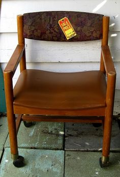 Before picture. This nasty old hotel chair has good strong casters and a solid frame. Remove the back, rip off the upholstery, saw off the arms, and then...