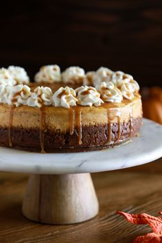 This amazing Pumpkin Cheesecake with Caramel Sauce is sure to become your new favorite fall dessert! It starts with a simple homemade gingersnap crust, then a layer of silky pumpkin cheesecake, topped with whipped cream and a drizzle of caramel sauce. Pumpkin Cheesecake Recipes, Pumpkin Recipes, Fall Recipes, Dessert Recipes, Tiramisu Cheesecake, Caramel Cheesecake, Cheesecake Desserts, Raspberry Cheesecake, Thanksgiving Recipes
