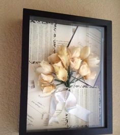 I really love this idea for putting wedding invitations and wedding flowers n a picture frame