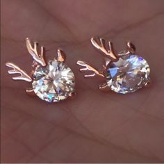 Antlered Crystals Earrings Gorgeous and tasteful stud earrings feature small, flashy, brilliant crystals with rose-ish gold tone color antlers. Brand new and unworn, no tags. No trades, no holding, no offsite/App payment.   All $9 earrings are two pairs for $15                     ❗️PRICES ARE FIRM❗️ Jewelry Earrings
