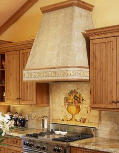 #Kitchen Idea of the Day: Kitchen Tile Murals & More Backsplash Ideas. Beautiful feature box backsplash and range hood.