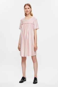 This short dress is made from a silky cotton jersey with a gathered frill detail…