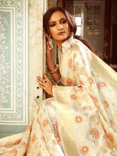 2f830cf900 Gorgeous Off-white Silk wedding saree is weaved in zari and resham work.  Ethnic Star Fashion