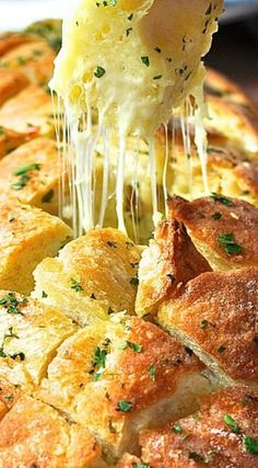Cheesy Garlic Pull Apart Bread - Ooey gooey Mozzarella cheese melted between a crusty Vienna bread loaf with warm melted butter mined garlic and seasoned to perfection with fresh parsley.
