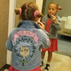 Girl power! Feeling her womanly charms and utterly loving herself! Photo shoot for slogan denim jacket with venus symbol. Mini feminist
