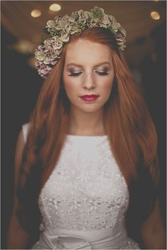 Floral headpiece wearing bride.