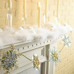 Create a memorable garland by gluing snowflake ornaments to music CDs, then tying the ornaments along a strand of beaded garland.