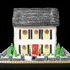 The white siding on this gingerbread house is made of white icing that was piped on using a small pastry bag tip. | Photo: Wright Creative