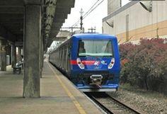Trem elétrico chegando na estação.