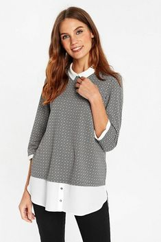 8060762a6fb Stay on trend with this light grey layered top.