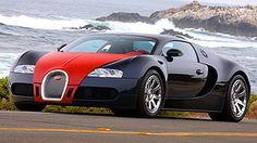 Daniel Simon / The Bugatti Veyron Fbg par Hermès with lower front facia, bolder horseshoe intake and special wheels.