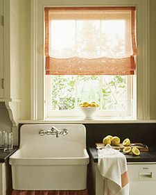 This free-flowing linen shade is perfect over a kitchen sink, where it filters sunlight while preserving the view.