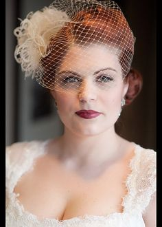 I'm obsessed with bird cage veils!  I'd love to get a shot of my eyes through the veil. Make up with be dark, dramatic and vampy. 40's dramatic darks