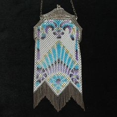 Beautiful marked Mandalian mesh bag with a striking geometric art deco design.  The bold colors of turquoise, purple, gold and black  on a cream color background found at www.rubylane.com @rubylanecom